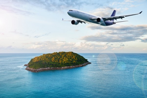 Passenger plane over tropical island